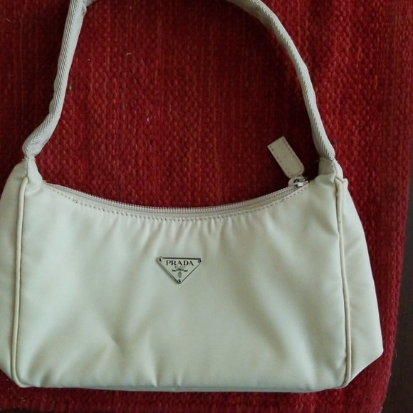 b87290ceba Authentic Vintage Prada Cream WinterShoulder Purse.  M_5b3b7277a5d7c630af92fcf5